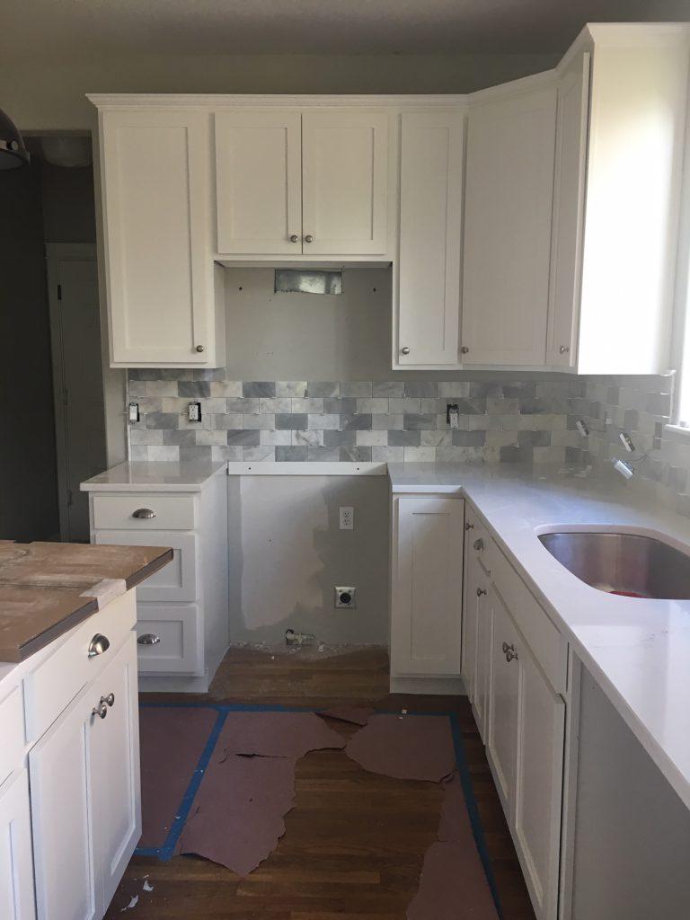 kitchen remodel white quartz counters.