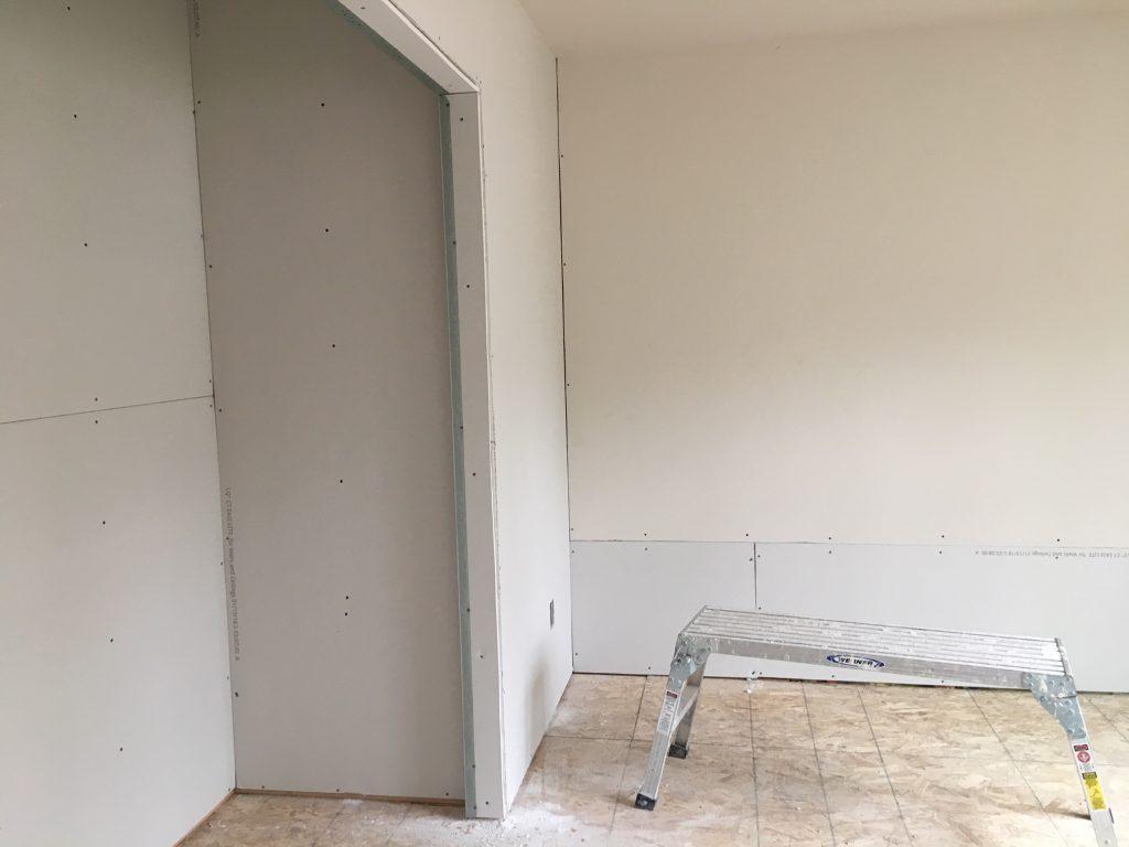 New bonus room being sheet rocked - adding a bonus room to a two-story living room.