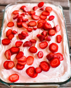 custard pudding layer cake with cool whip and strawberries